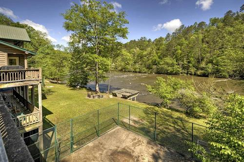 River access, basketball court, dock, hot tub and fire-pit