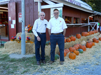 Marvin and Barry Pritchett in front of the Red Apple Barn