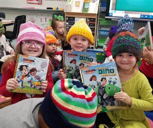 Books and knitted hats delivered to the children