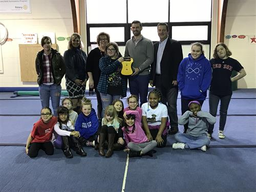 In A Heartbeat donating an AED to Girls Incorporated of Meriden