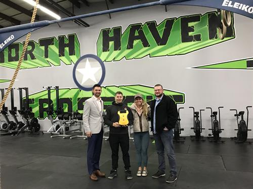 In A Heartbeat donating an AED to North Haven CrossFit