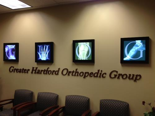 Lighted custom signs, acrylic dimensional letters in waiting room