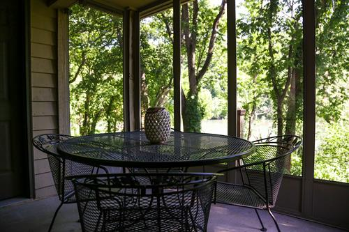 Screened in patio with lakeside view