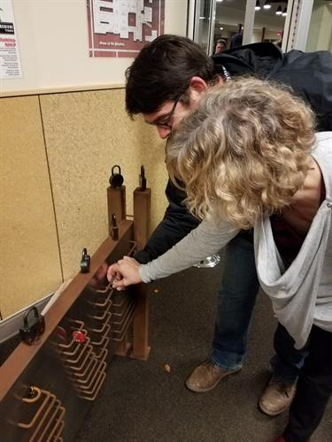 Sweethearts place their lock together on the prototype November 2017