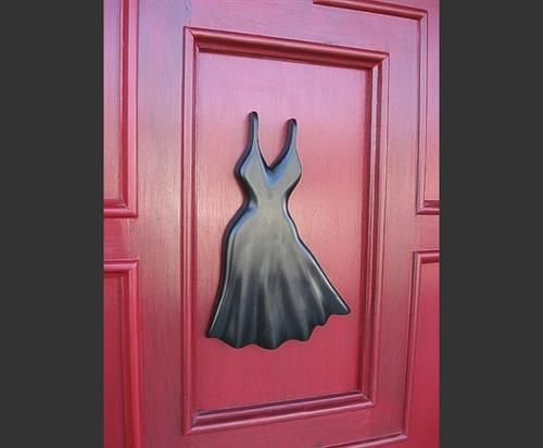 Multi-panel mahogany door sourced, fitted, and stained, with custom relief art created for clothing boutique.