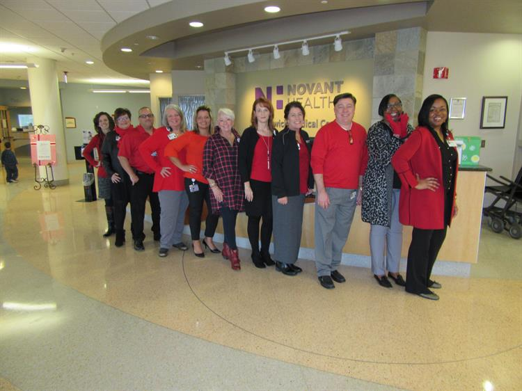Novant Health team members dress in red to celebrate National Wear Red Day to raise awareness for women and heart disease.