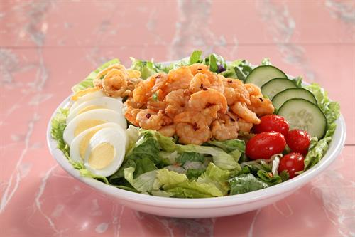 A Coastal Classic, Golden Fried Shrimp over a Fresh Salad