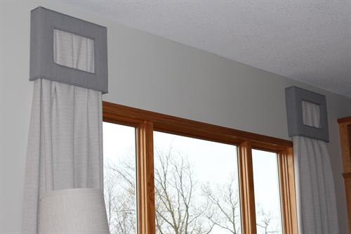 Custom draperies and peek-a-boo cornices