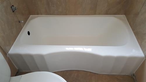 Look at that same tub now.... we refinished it to it beautiful state.