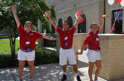 An enthusiastic staff welcomes the students on the first day