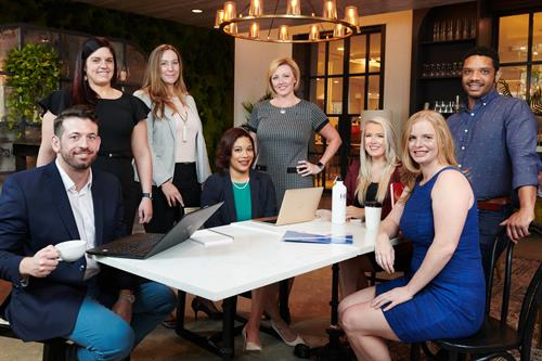 Gallery Image hr_nola_team_shot_sitting_table.jpg