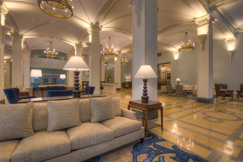 Grand Lobby - NOPSI Hotel, New Orleans features a sweeping lobby with faithfully renovated vaulted ceilings, graceful arches, ornamental columns, brass grills and stone terrazzo flooring.