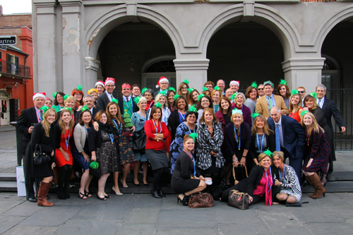 GEB associates smile for a photo opp at the annual Christmas luncheon.