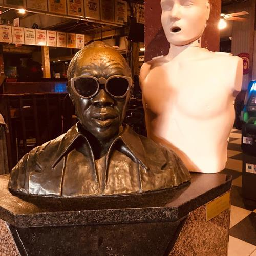 "Tipitina's namesake Professor Longhair and CPR training manikin, ""Fess""."