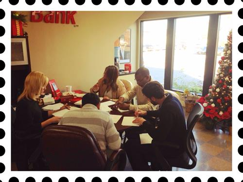 Signing Christmas cards for our wonderful customers.