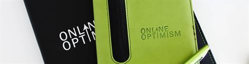 We take notes on our digital marketing campaigns in these bright green notebooks.