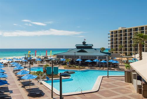 Relax sipping a cold beverage while enjoying the breeze on our pool/beach deck