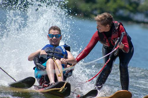Chad, a real Care Wisconsin member participating in adaptive water skiing