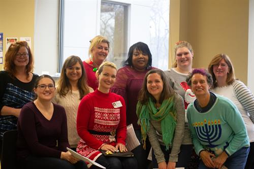 Employees participating in a Winter Holiday Party Fundraiser