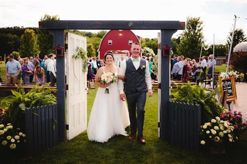 Gallery Image Austin_Tori_Wedding-end_back_out_doors.jpg