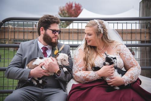 Gallery Image Sarah_and_AJ_holding_goats_2020.jpg