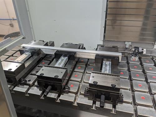 3 Vises lined up to hold extra long parts