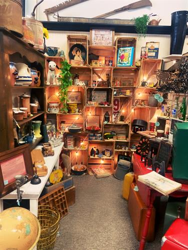 Our Rusty, Dusty, & Earthy booth. A great mix of  items ranging from antique oil cans and vintage poker chip sets, to North Carolina made pottery!
