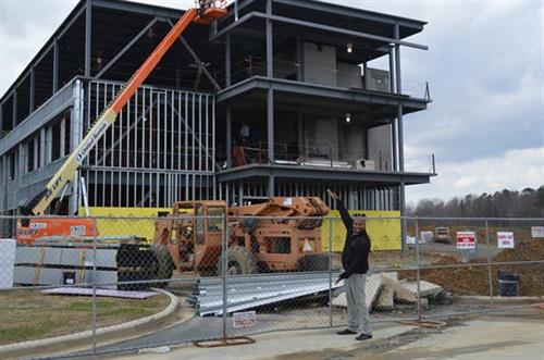 February 2014 - Principal Erby pointing out the future High School Building