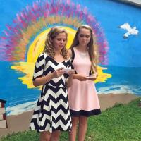 Girl Scouts paint mural on Neuse Riverwalk