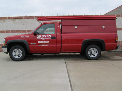 Our familiar red Groves Electric Service trucks