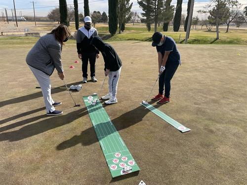 Junior player being trained using the Delta Putt and Delta Dueler