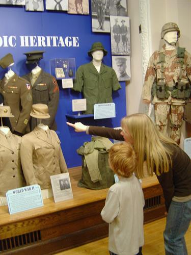 Gallery Image Heather_and_Jed_pointing_at_military_display.JPG