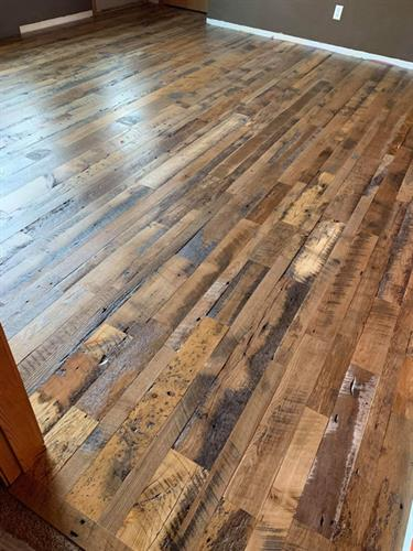 Skip Planed Flooring Made From Reclaimed Wood Installed in a Home in Wisconsin Dells, WI