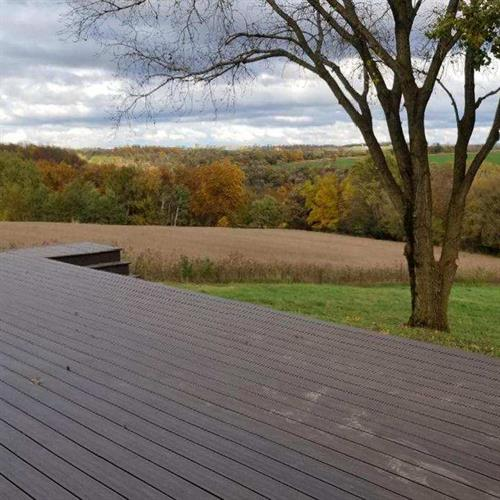 The NEW 16' x 72' deck along the entire back of the barn makes the perfect place to sit and take in the ridge top views!