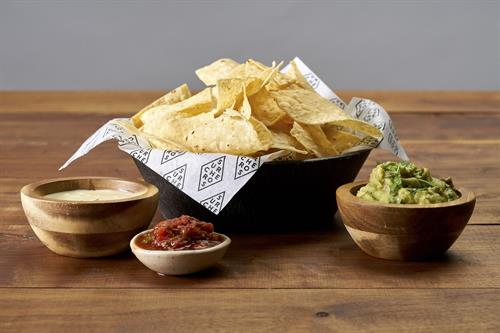 Crispy chips with white cheese dip or homemade salsa or guacamole
