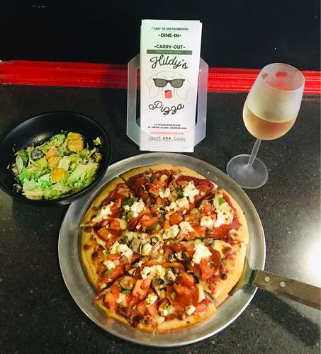 Build-Your-Own pizza! Add a salad and glass of wine for the perfect meal!