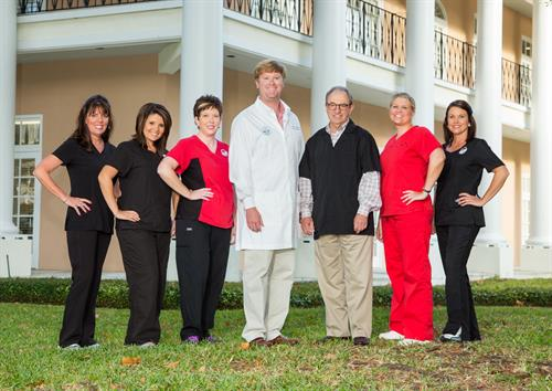 Dr. Hopkins, Dr. Melton, and the staff of Plantation Dental Associates