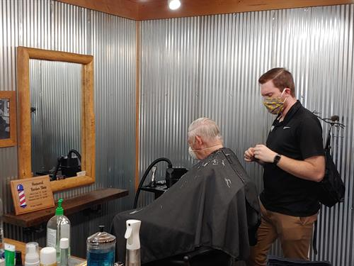 The owner Evan Giving a cut