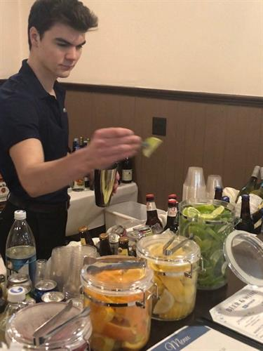 Mixing drinks at a mobile bar event!