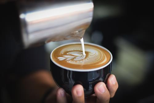 Gallery Image Canva_-_Close-up_of_Woman_Holding_Coffee_Cup_at_Cafe.jpg