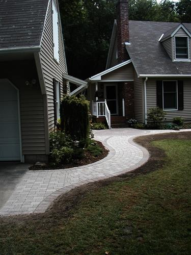 Walkways should anticipate where foot traffic will come from to keep mud out of the house