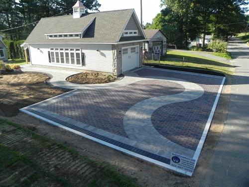 permeable paver driveways allow rainwater and snow to seep into the ground, minimizing runoff.