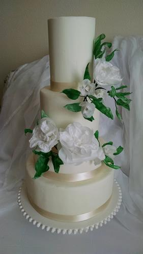 Wedding cake adorned with wafer paper flowers