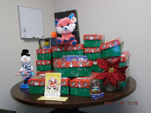 A Mountain of Shoeboxes provided for Operation Christmas Child by Administration employees