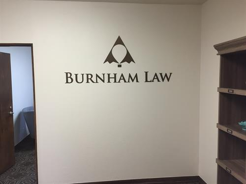Brushed bronze dimensional letters and logo for law firm in Boulder