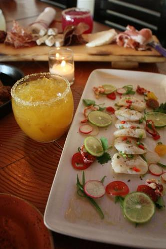 Our SCALLOP CEVICHE is a flavor explosion! Lime, green onion, candied fresno chile, heirloom tomato, radish, smoked salt, extra virgin olive oil