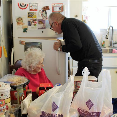 Joe unloads groceries for his mother, Bernice, who participates in our Elder Share program.