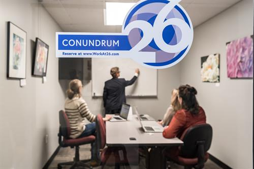 Conundrum conference room for up to 6 people. Hourly and daily meeting room rental