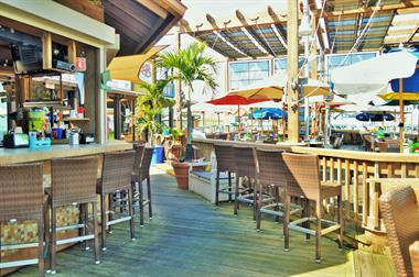 cozy seat on the water, and see the tiki bar