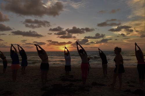 Half Moon Pose catches the Sunrise at our once a month Beach Yoga Class and Clean-up with Keep Brevard Beautiful